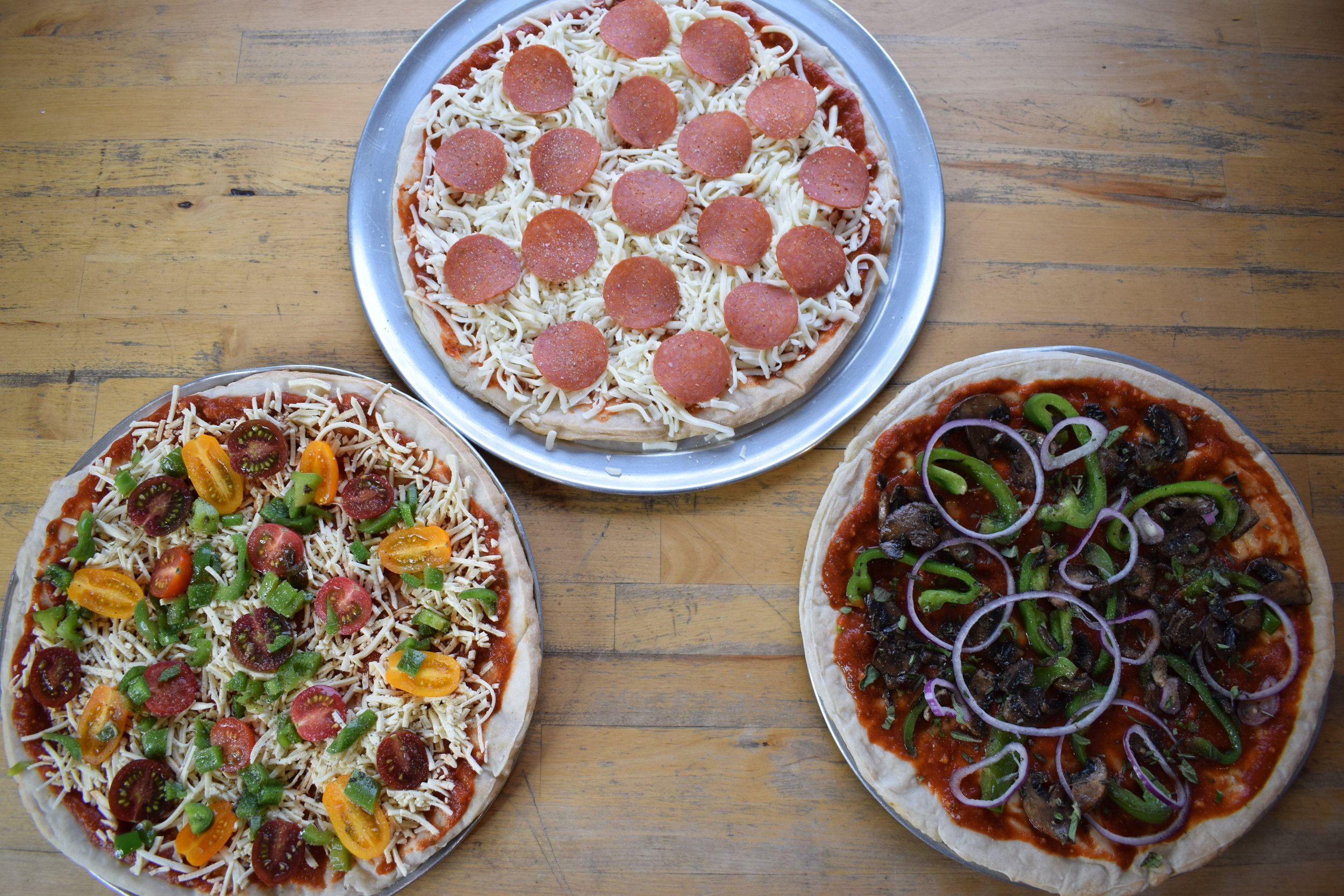 We made a pizza for everyone! A pepperoni with regular cheese, a veggie pizza with vegan cheese, and a pepper, mushroom, onion pizza with fresh herbs!