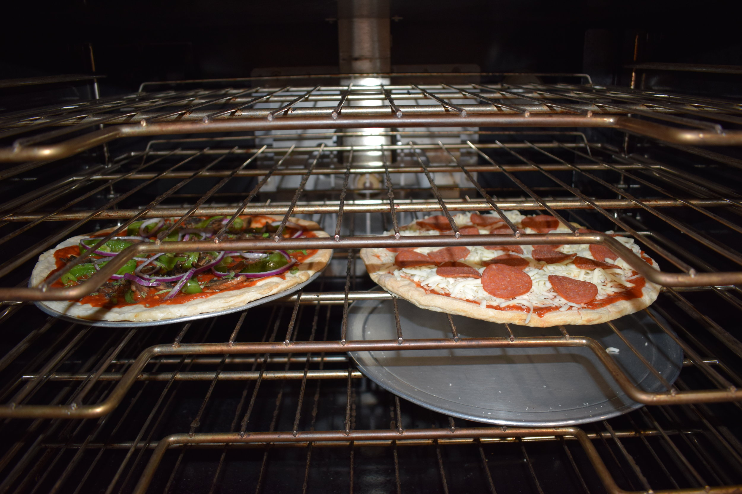 Bake on a pan for a softer crust, or bake directly on the rack (with a pan on the rack below to prevent spillage) for a crispier crust.