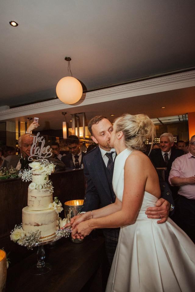 Emma Ollies cut the cake.jpg