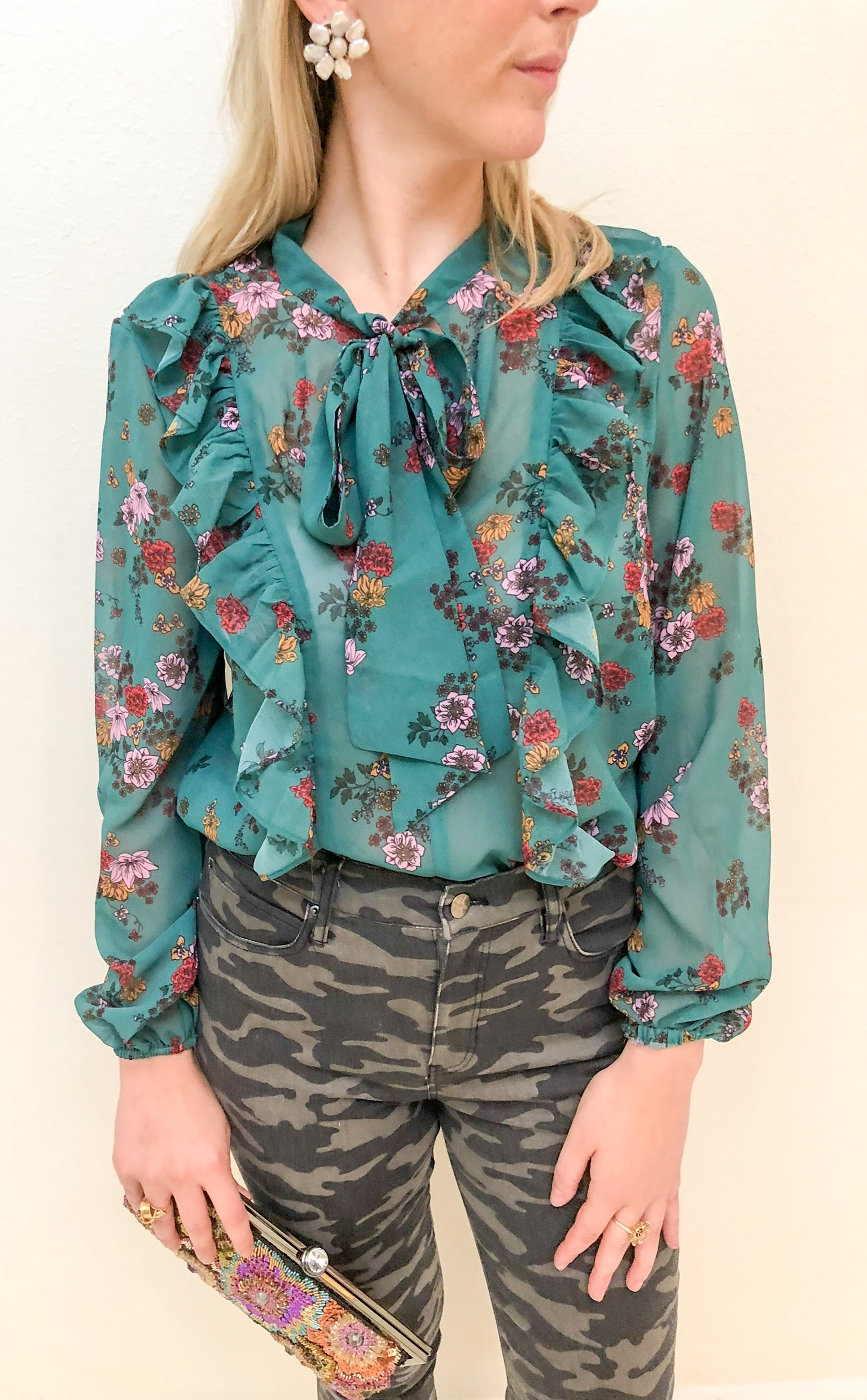 First Look: - First Look: Emerald is one of the season's hottest colors. Pair this floral bow neck blouse with a more neutral camo denim for a sweet and sporty look.