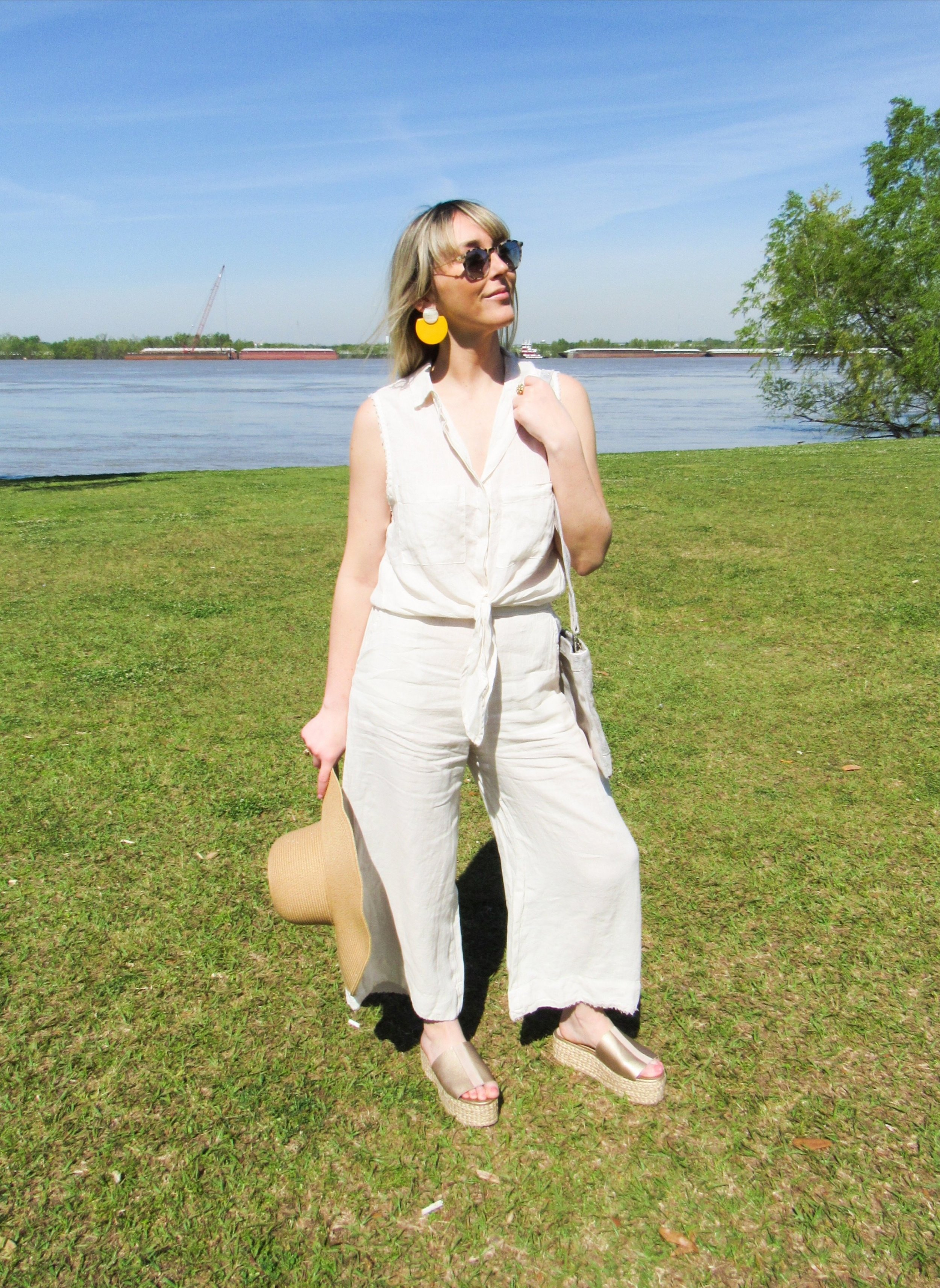 Short Sleeve Button Down - This classic linen button down with a front tie is perfect for a hot summer day. Dress it up with white jeans and wedges.