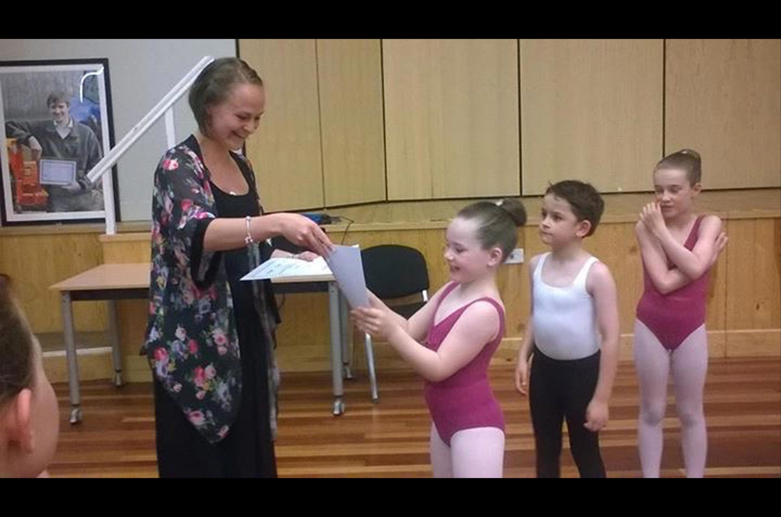 Miss Donya handing out dance certificates ballet
