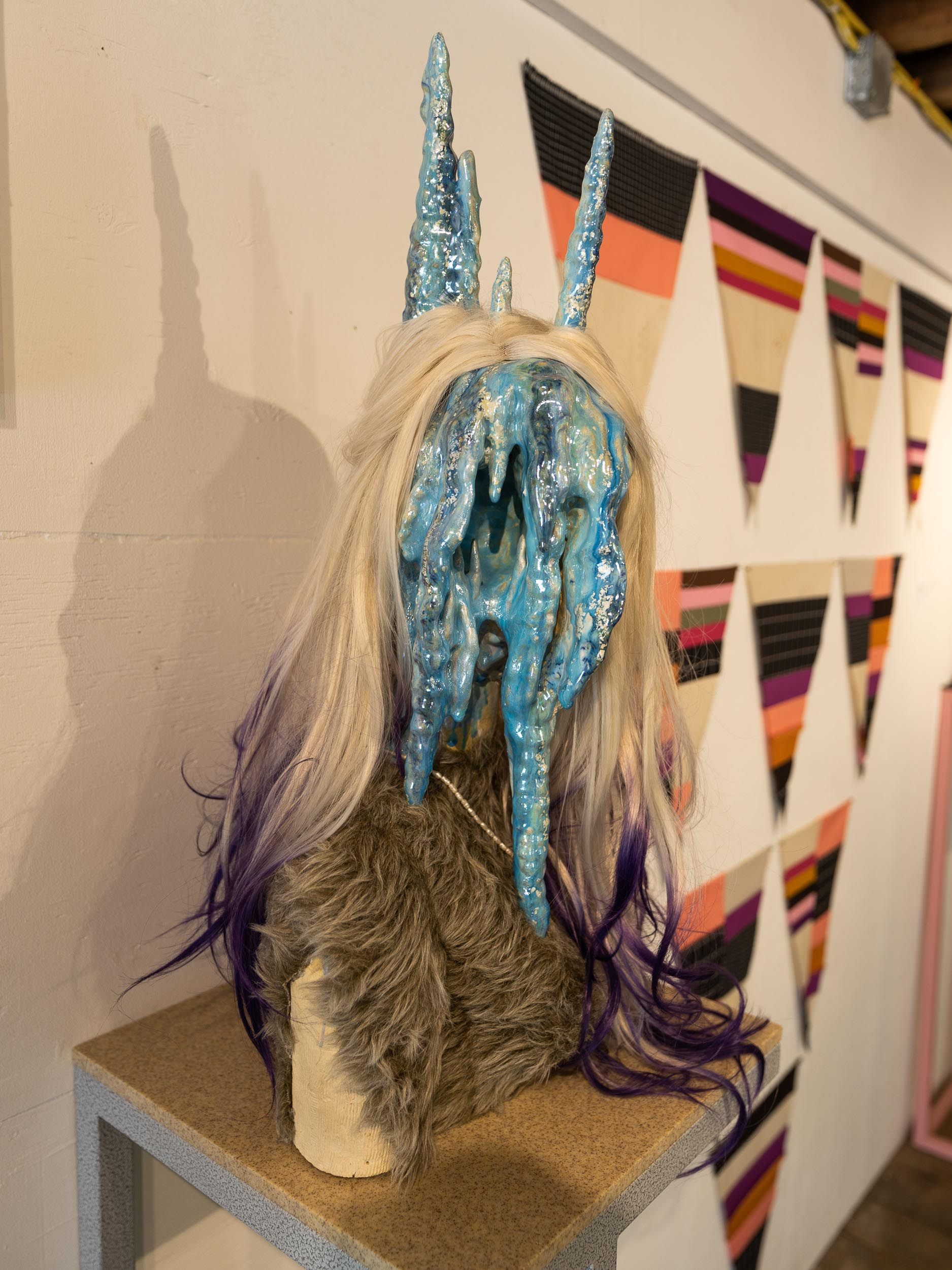 Roxanne Jackson,  Bedroom Eyes  (2018) Ceramic, glaze, luster, wig, freshwater pearls, faux fur; 16 x 28 x 11 inches