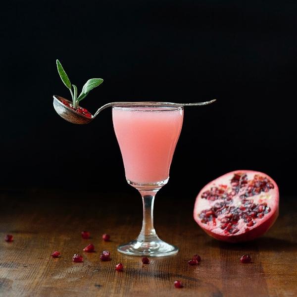 amaterasu - the sun goddess cocktail - sake, pomegranate, buddha's hand, yuzu