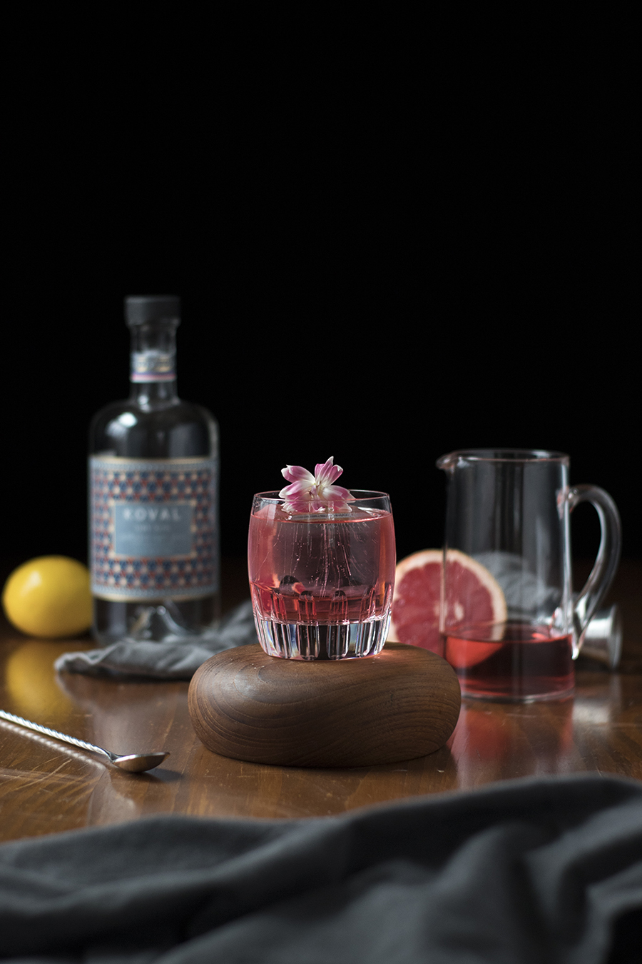 milk clarified cocktail with gin, hibiscus, caramelized bananas, grapefruit, lemon