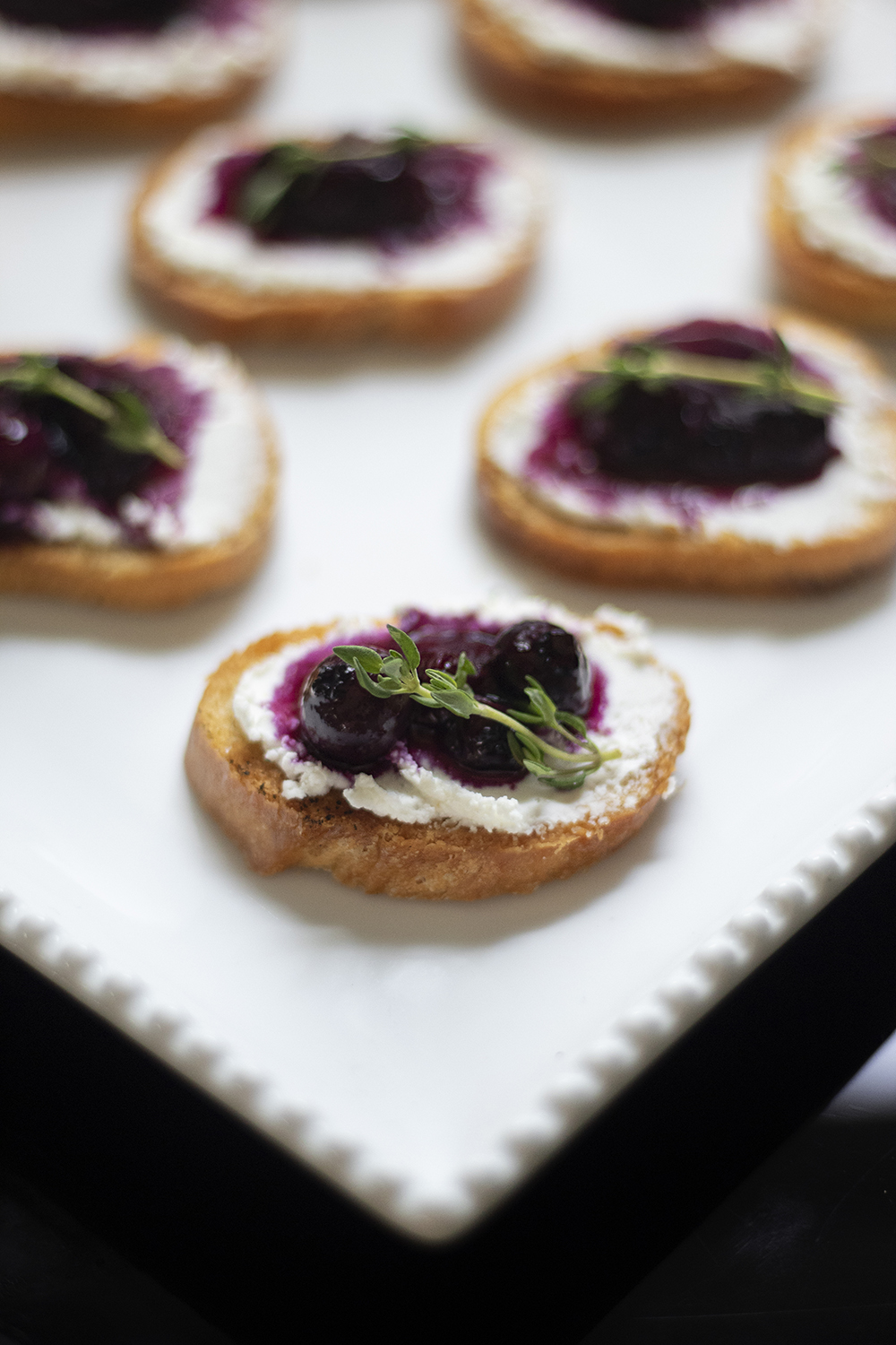 Blueberry Bourbon Reviver Cocktail with Blueberry Thyme Goat Cheese Crostinis