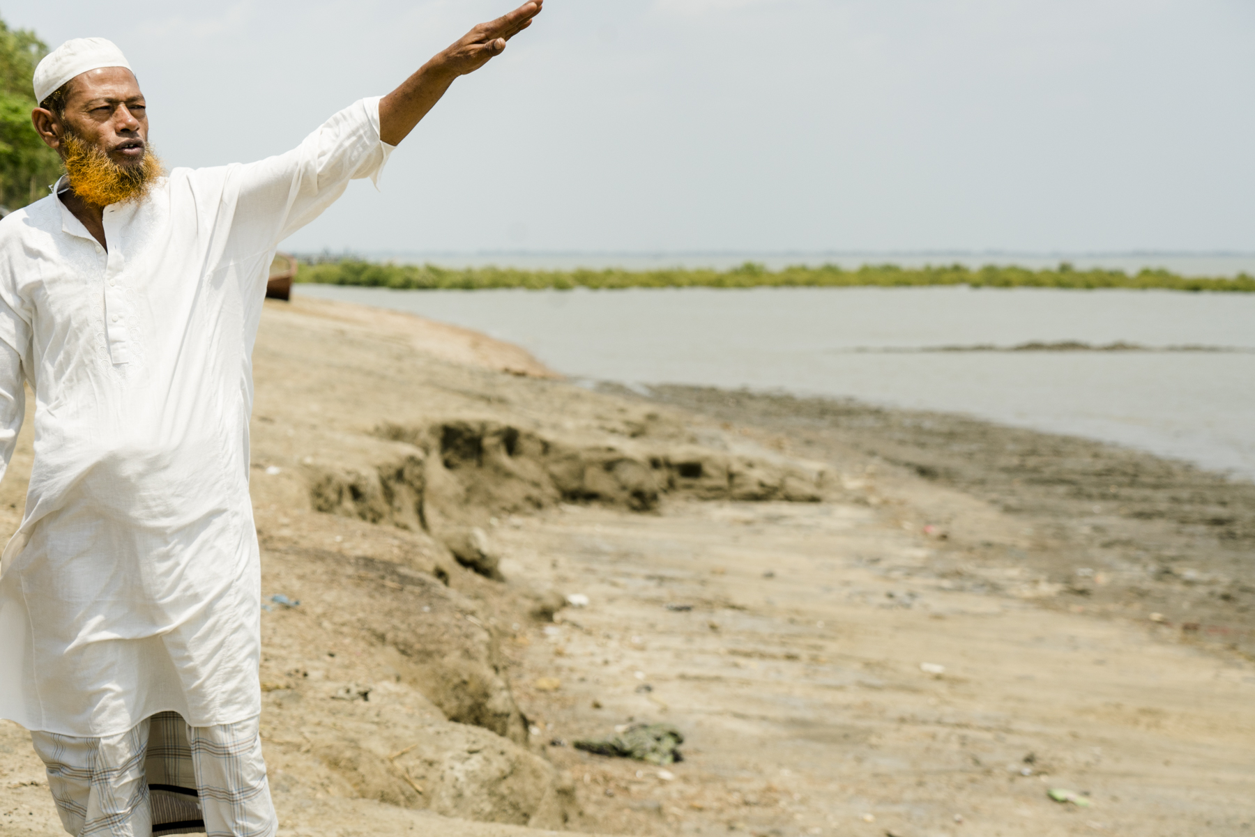 Zafar pointing to where his home used to be.