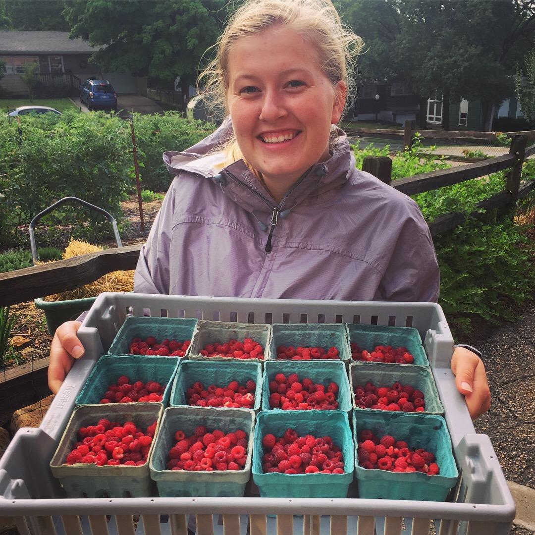 Elise + raspberries.JPG