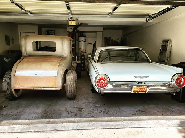 """Never really considered myself a """"Ford owner"""" more gm threw and threw however I am digging my garage view! New acquisition """"Betty Jane"""" on left thanks to the bros at @hotrodranch and the ladies """"Astro"""" 63 bird on right. #modelaford #1963tbird #hotrod #31coupe #builtfordtoughwithhemistuff #ford #blueoval #hopup"""
