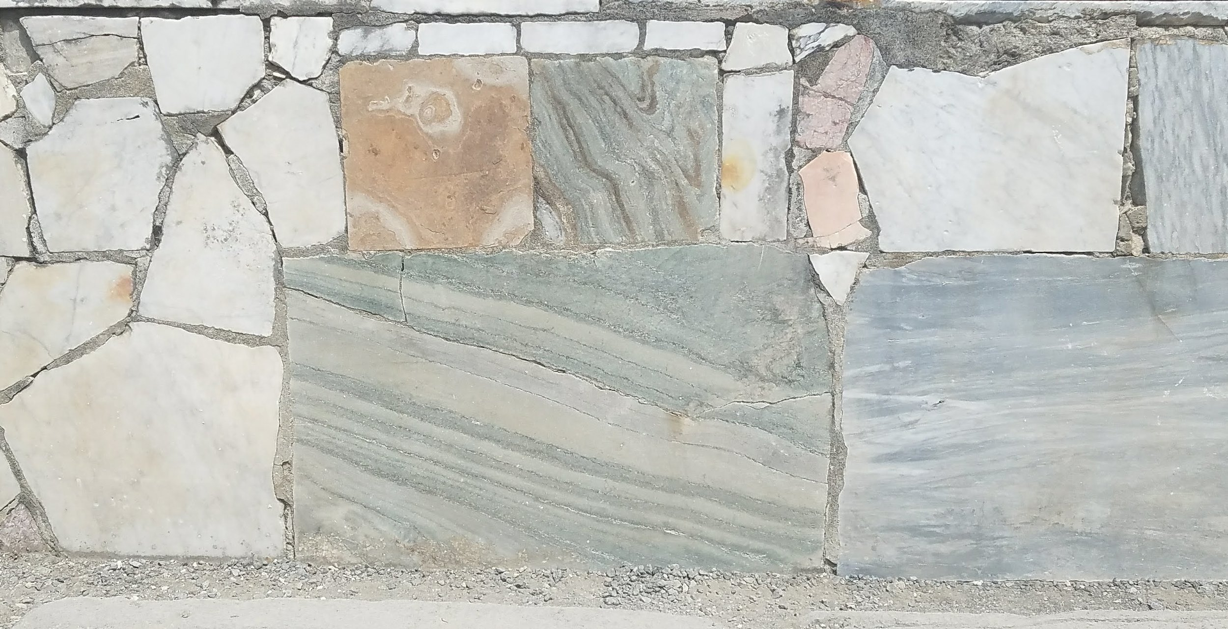 Detail marble wall in the ancient city of Pompeii.