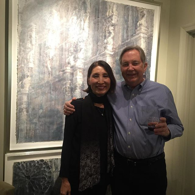 Chizuru Morii Kaplan with Greg Hubert in front of 'Melodious Paris' at our opening for the artist. @hubertgallery#chizurumorii kaplan#paris#architecture#warercolor#decor#interiordesign