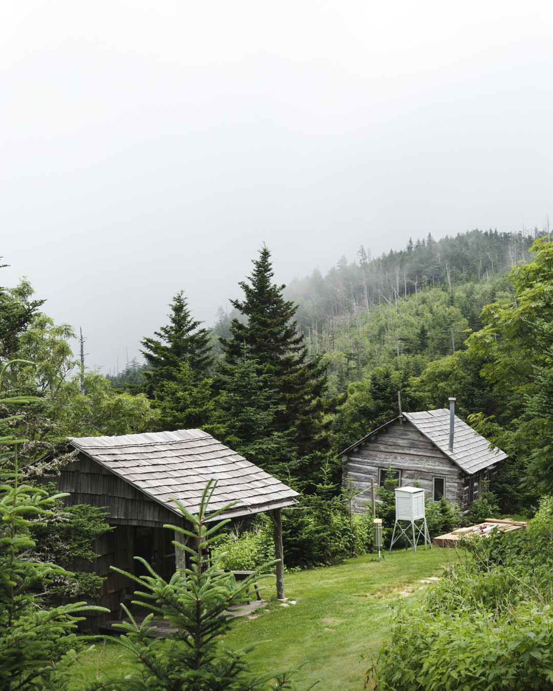 This image is slightly overexposed to blow out the sky. This adds to the moody atmosphere of the cabins