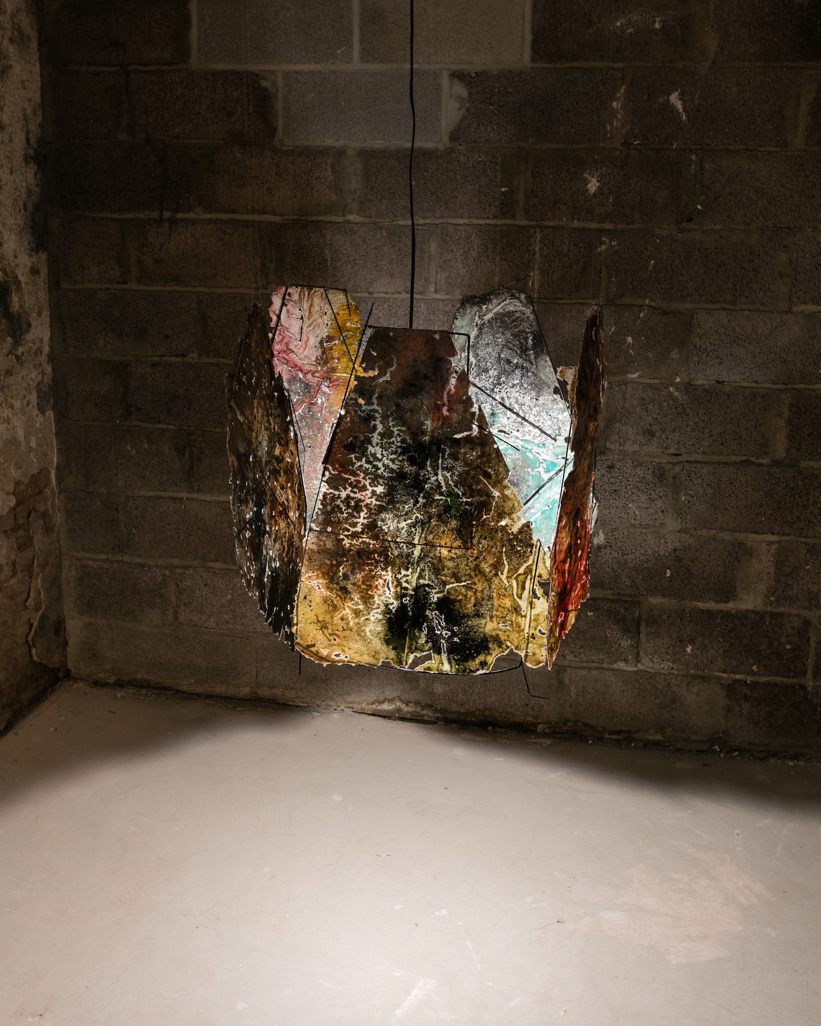 Vanessa Thill  The Lanterns,  2018 Salt, spray paint, microbeads, spices, charcoal, coffee, wine, fake blood, fabric dye, glue, resin, and mixed media on paper; umbrella spokes, wire, and thread; light fixture 24 x 30 x 30 inches