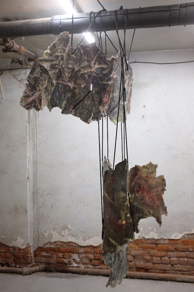 Vanessa Thill  The Green Split (CTKO) , 2018 Ink, fabric dye, sand, shampoo, engine degreaser, concrete pigment, glue, resin, and mixed media on paper; nylon rope, clay, and wool 72 x 45 x 12 inches