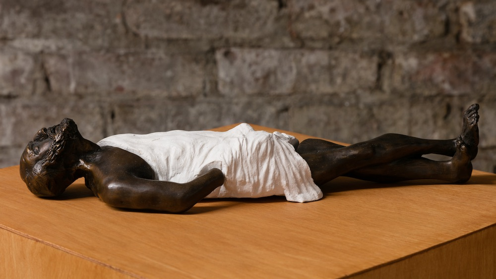 Eric Wesley  New Realistic Figures (Sleeping): Plato , 2015 Faux marble and bronze on stained maple pedestal 3.75 x 9 x 16 inches, pedestal: 56 x 11.5 x 11.5 inches