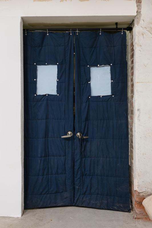 Chris Zacher  Blue door with window , 2018 Bed sheet, door handle, plexiglass, aluminum, wood, shower curtain rings, hardware and shoelace 48 x 82 inches