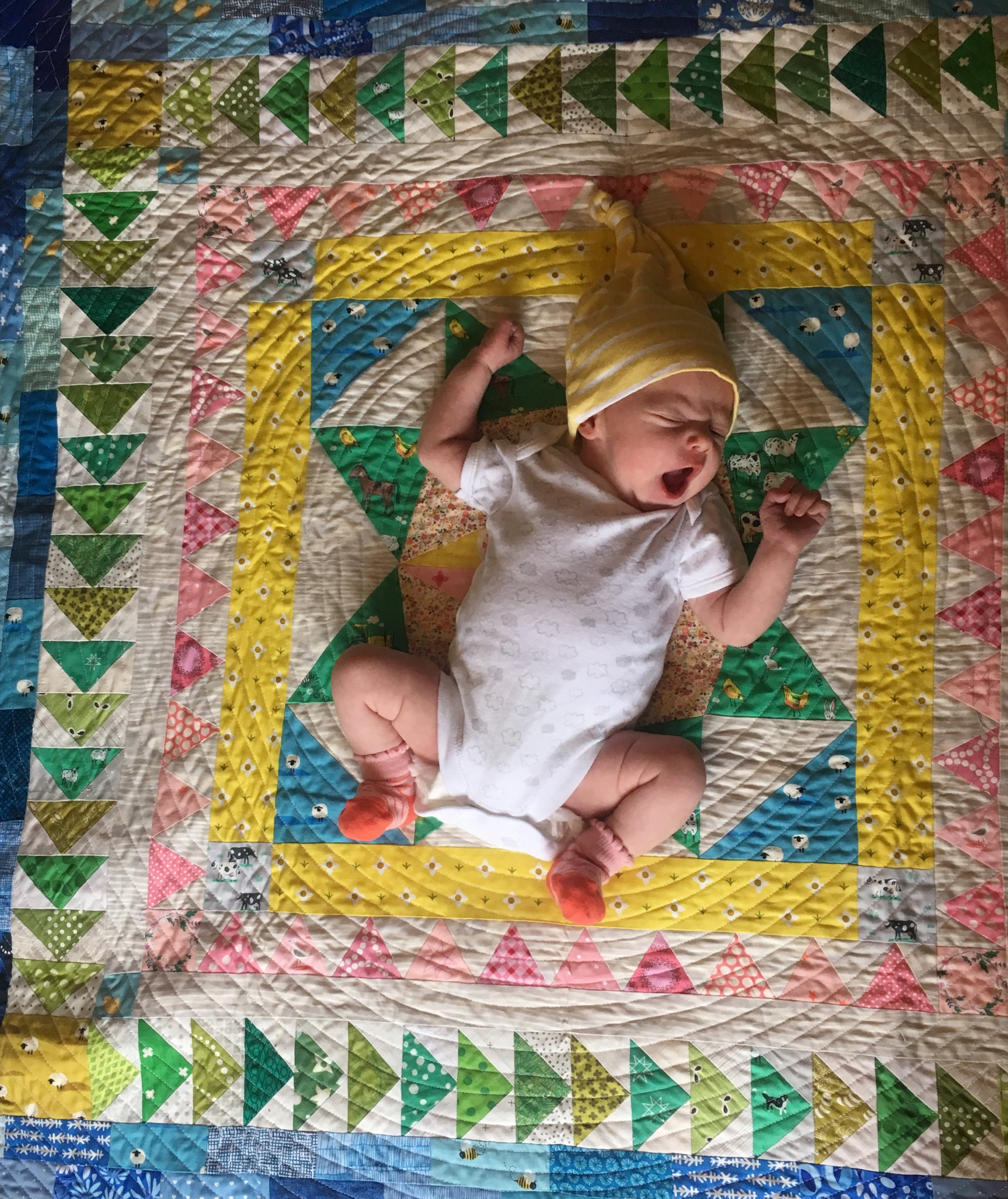 This  Marcelle Medallion quilt  by  Alexia Abegg  is one of my favorites to make. it's such a great size for kids to grow up with, plus the borders let you customize endlessly. I didn't know Mars would be a girl when I started, but the quilt seemed to know. :)