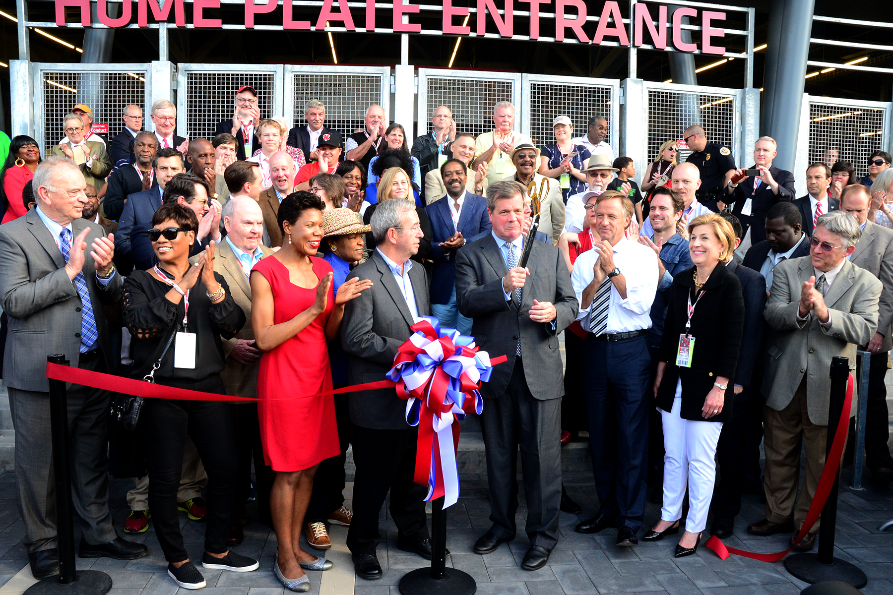 Former Mayor Karl Deal celebrates the Grand Opening after the Ceremonial Ribbon Cutting with Owner Frank Ward, Governor Bill Haslam, First Tennessee President-Middle Tennessee Region Carol Yochem, Pacific Coast League President Branch Rickey and other esteemed city and baseball dignitaries.