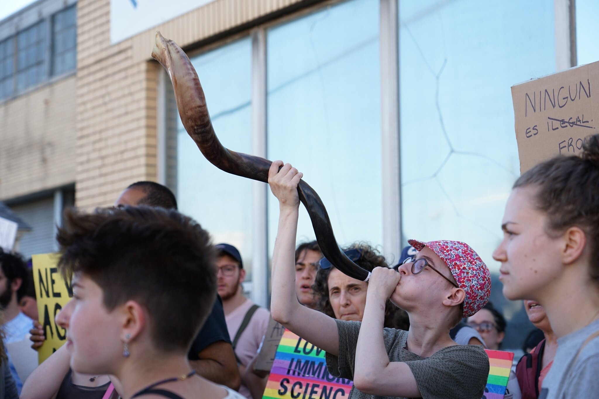 Blowing the traditional shofar, to awaken us to injustice.