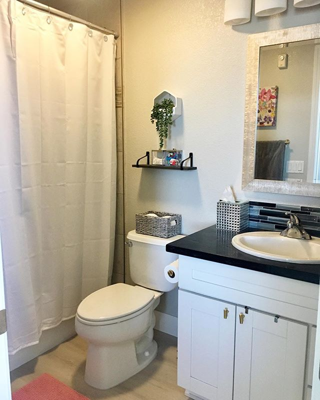 Some before and afters of my bathroom 😀 Slide to see more. My favorites are the new luxury vinyl plank floors and framed mirror. Even changing out the hardware for brass made a big difference.💚 #design #masterbath #remodel #moving #interiordesign #organized #glam #modernupdate #designer #decorating #home #california #stylized #homedesign #beforeandafter