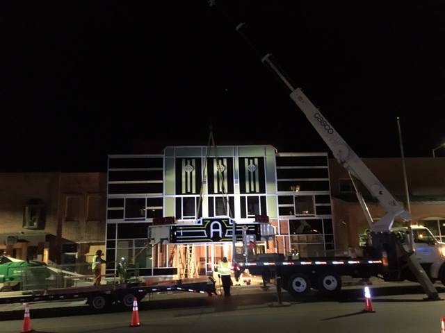 The new Appalachian Theatre marquee is hoisted into place, November 2016.