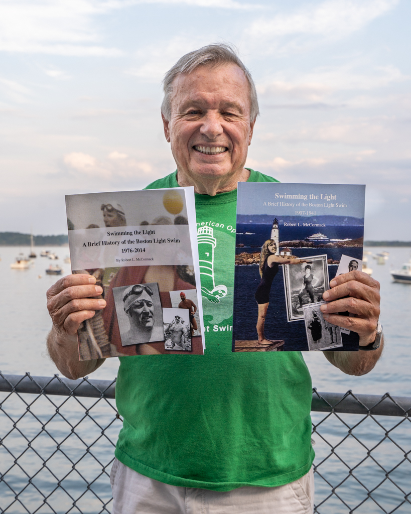 Bob McCormack poses with his two-volume history of the Boston Light Swim at the pre-race dinner in 2018. McCormack previously held the record for being the oldest solo finisher (age 67 in 2005) and became the oldest relay finisher in 2018 at age 80. We are grateful for his ongoing support and diligent work preserving the history of this great event!