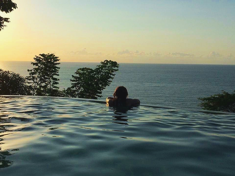 peaceful sunset soaks in our salt water infinity pool