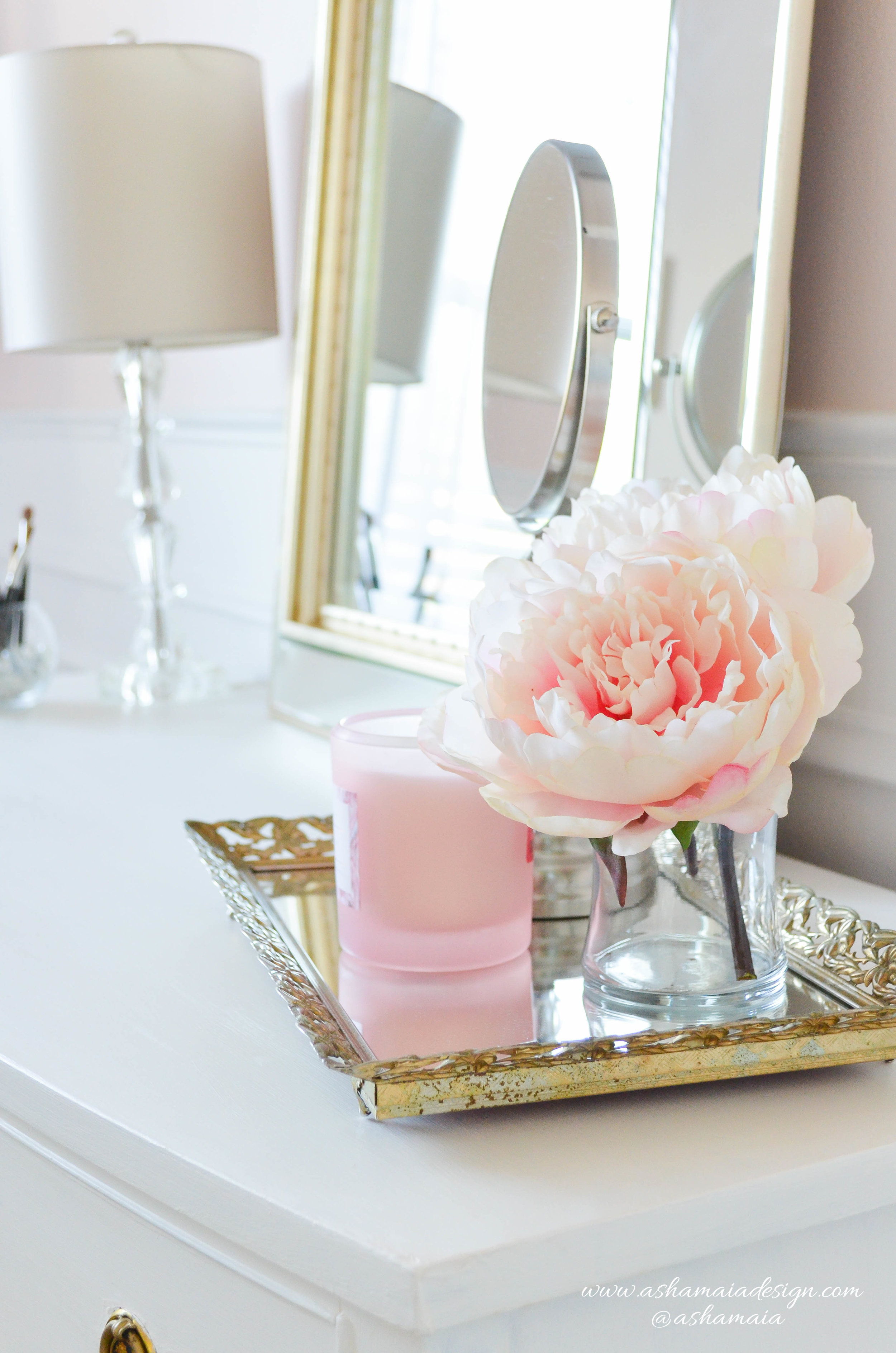 Intimate White Parisian Style Elegant Beauty Room with White Wainscoting, White Traditional Makeup Vanity with Gilded Mirror and Peonies in Vase