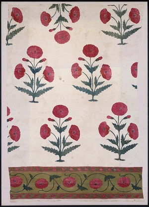 """Driving home the immense popularity of poppies in Mughal art, this thin cotton floor spread is printed with fairly realistic poppy plants with red double flowers, and a border with additional double poppy blooms worked into a scroll. """"Fragment of a Floor Cover,"""" possibly from Burhanpur, late seventeenth to early eighteenth century; Source: Museum of Fine Arts, Boston."""