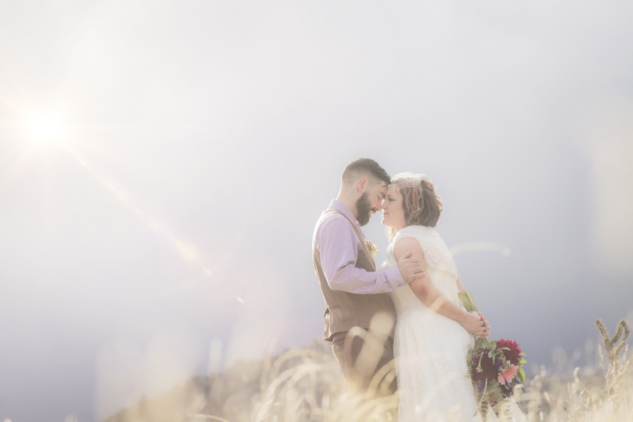 This couple eloped ! It was the sweetest wedding ever held right at the peak of light during the Balloon festival!