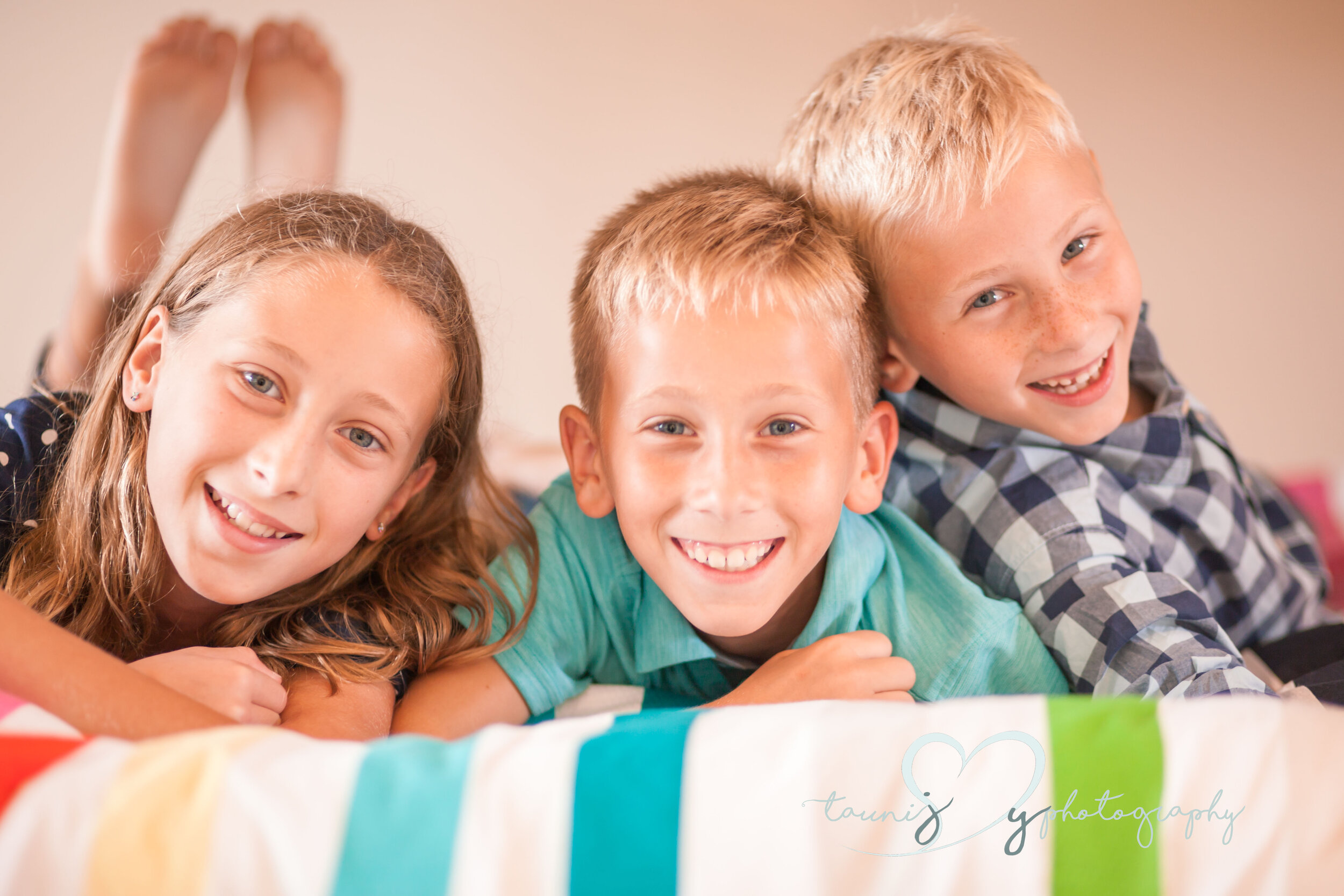 I thought the kiddos comforter was so cute ! It matched everyone perfectly . Look at those sweet smiles .