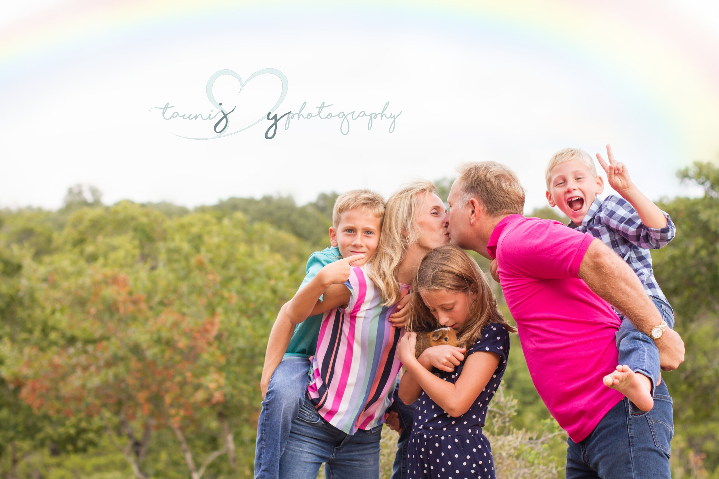 This family images made me giggle and smile . I love the oldest boy pointing to mom and dad , the younger one saying peace and the daughter just lovin on her pet guinea pig . All wrapped up doing their own thing showing their personalities.  And hello sweet rainbow popping out after the rain to embrace the chaos.  Thank you for opening your to me to capture your family !  Inspired me to host some family fun game nights this weekend!  Tauni Joy photography