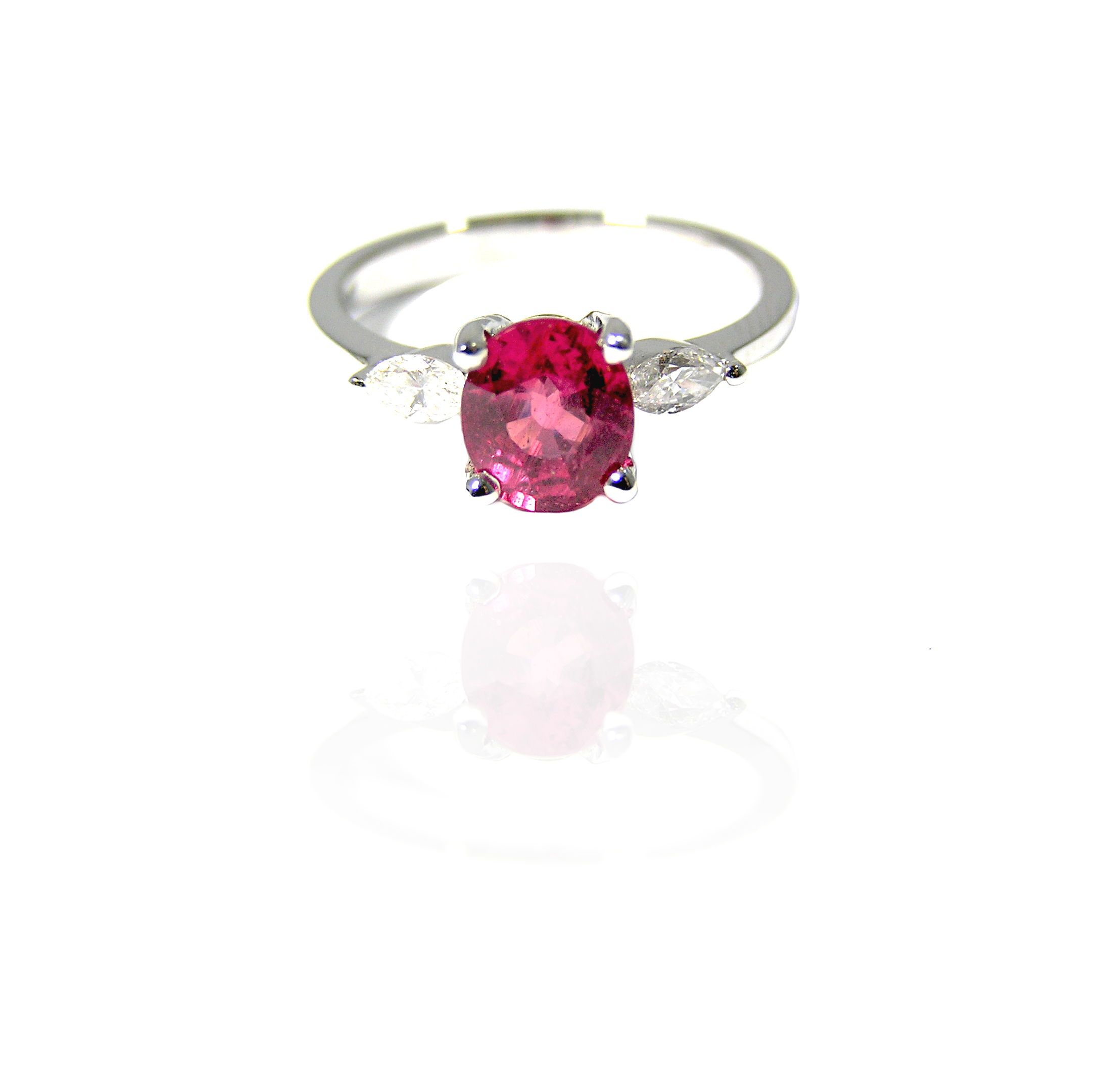 Ruby ring nestled between diamonds!