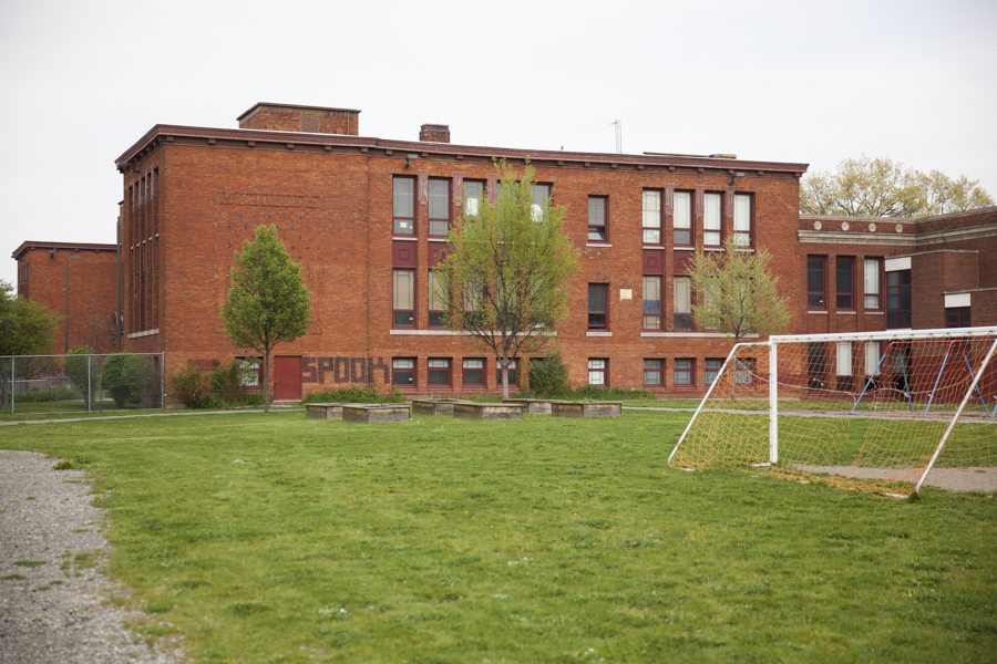 Recent landscape improvements have made the areas outside the school more welcoming for neighbors with seating, newer soccer and playground equipment, and basketball court as shown here from bordering Evans Street.