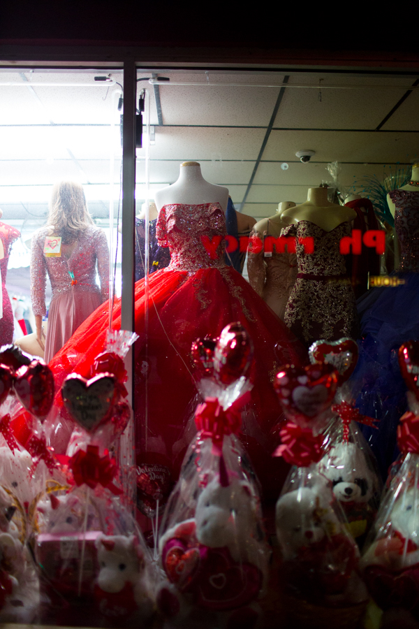 A Valentine's Day window display lights up the street at Delia's Fashion on W Vernor Hwy and Springwells in Southwest Detroit.