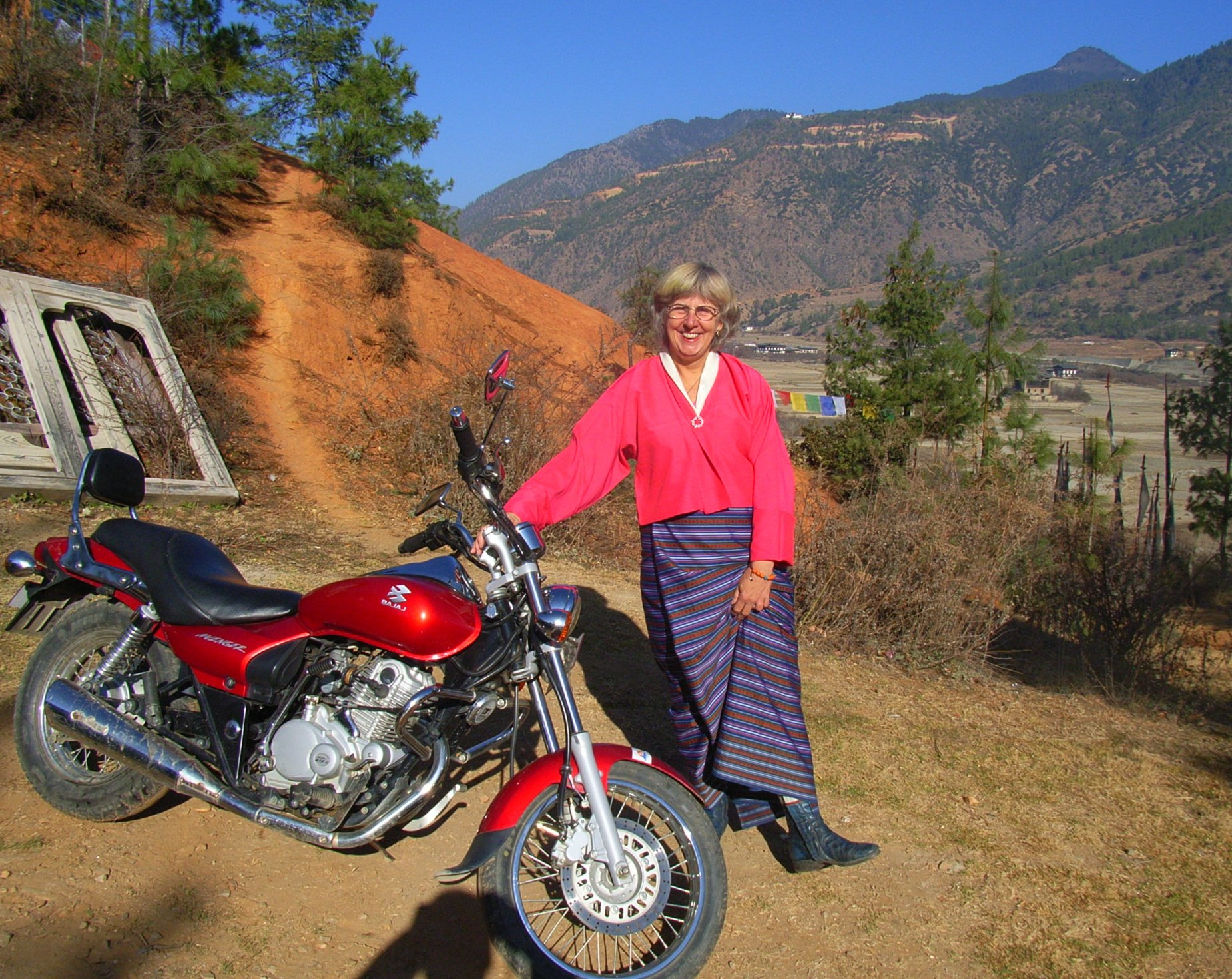bhutan, i did ride in my alpine star boots but not the bhutanese outfit. my guide rode in a car with his driver.