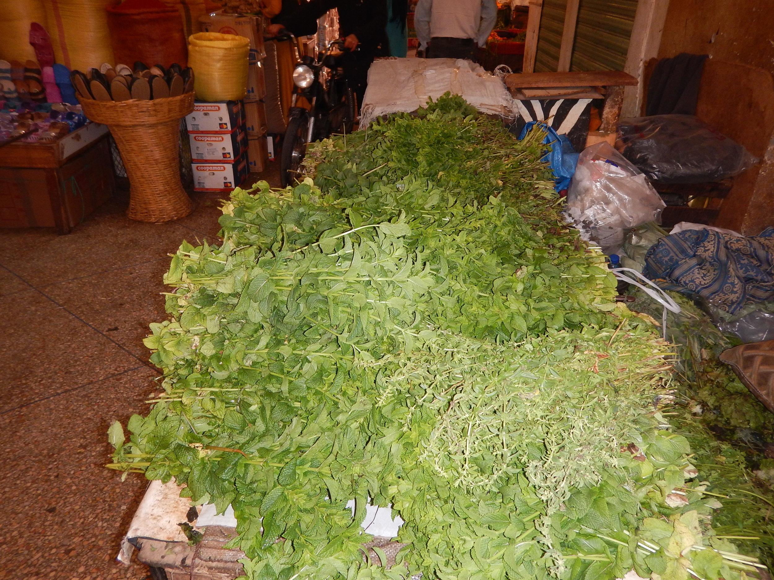 barrow load of fresh picked tea at the night market.
