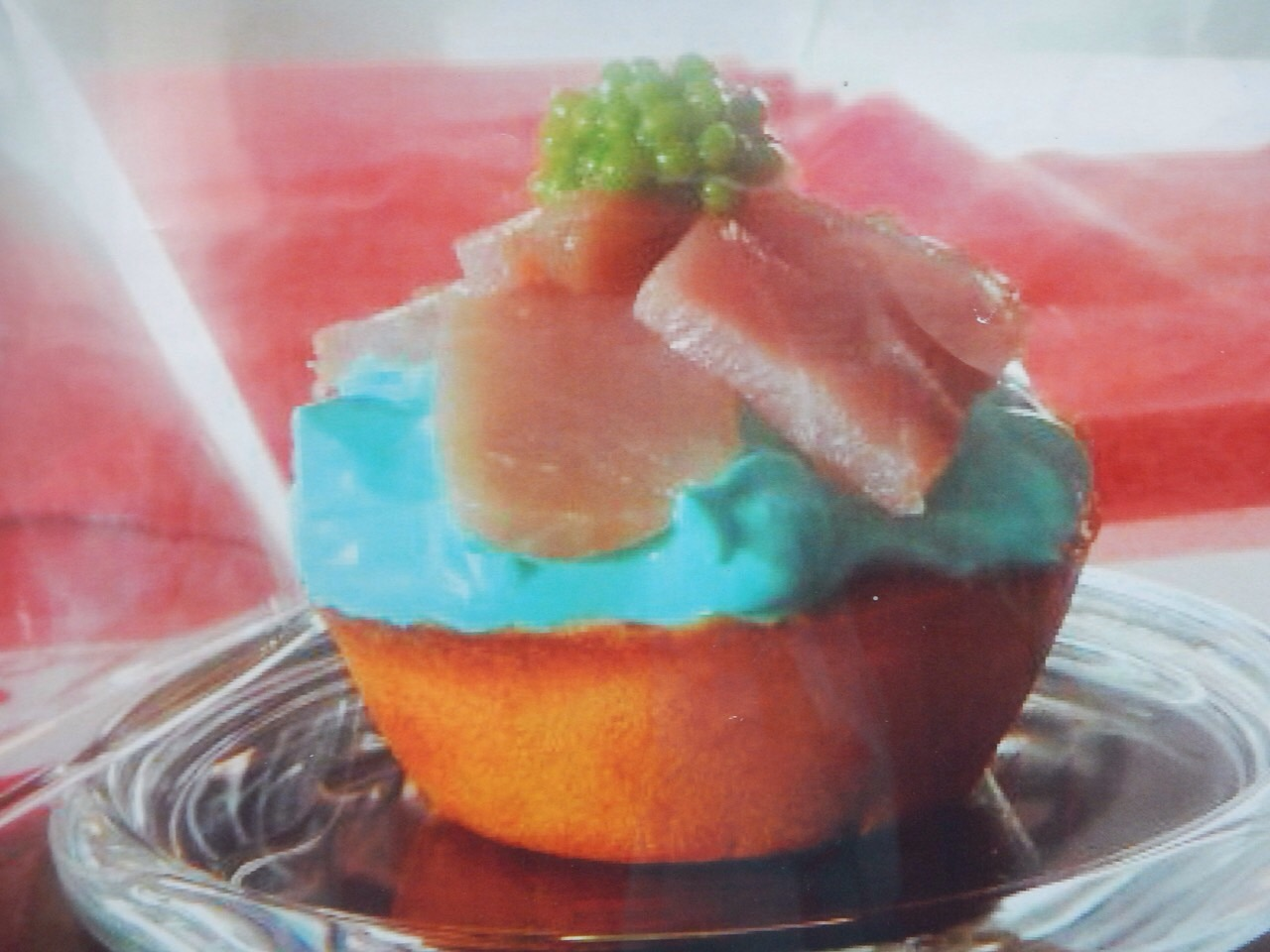 cup cake a la tuna. The base is like a donut bread, then cream cheese, tuna and roe, all served on a little plate under a glass bell jar. This dish deserves an award just for presentation alone.