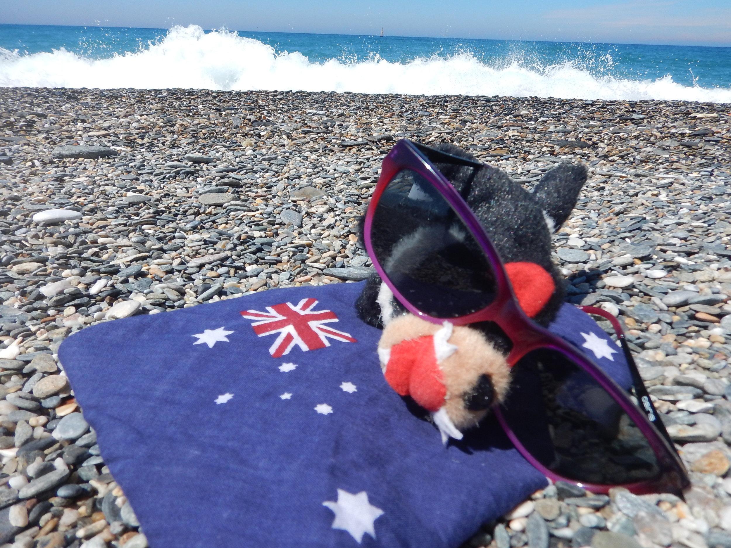 Harri catching a few rays on his Aussie beach towel.