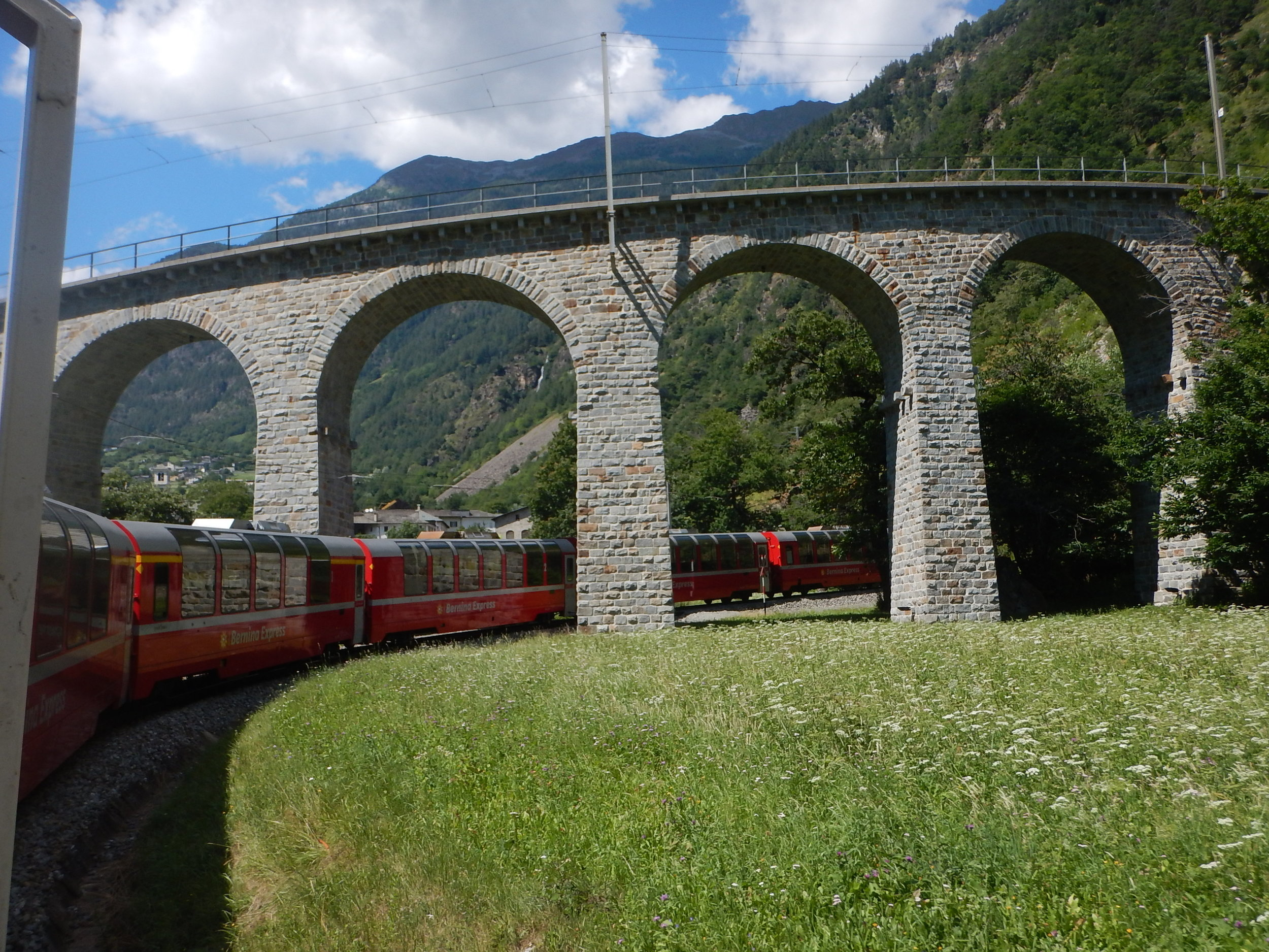 an exotic hairpin bend, the Bernina Express scenic train does this amazing loop back under itself!!