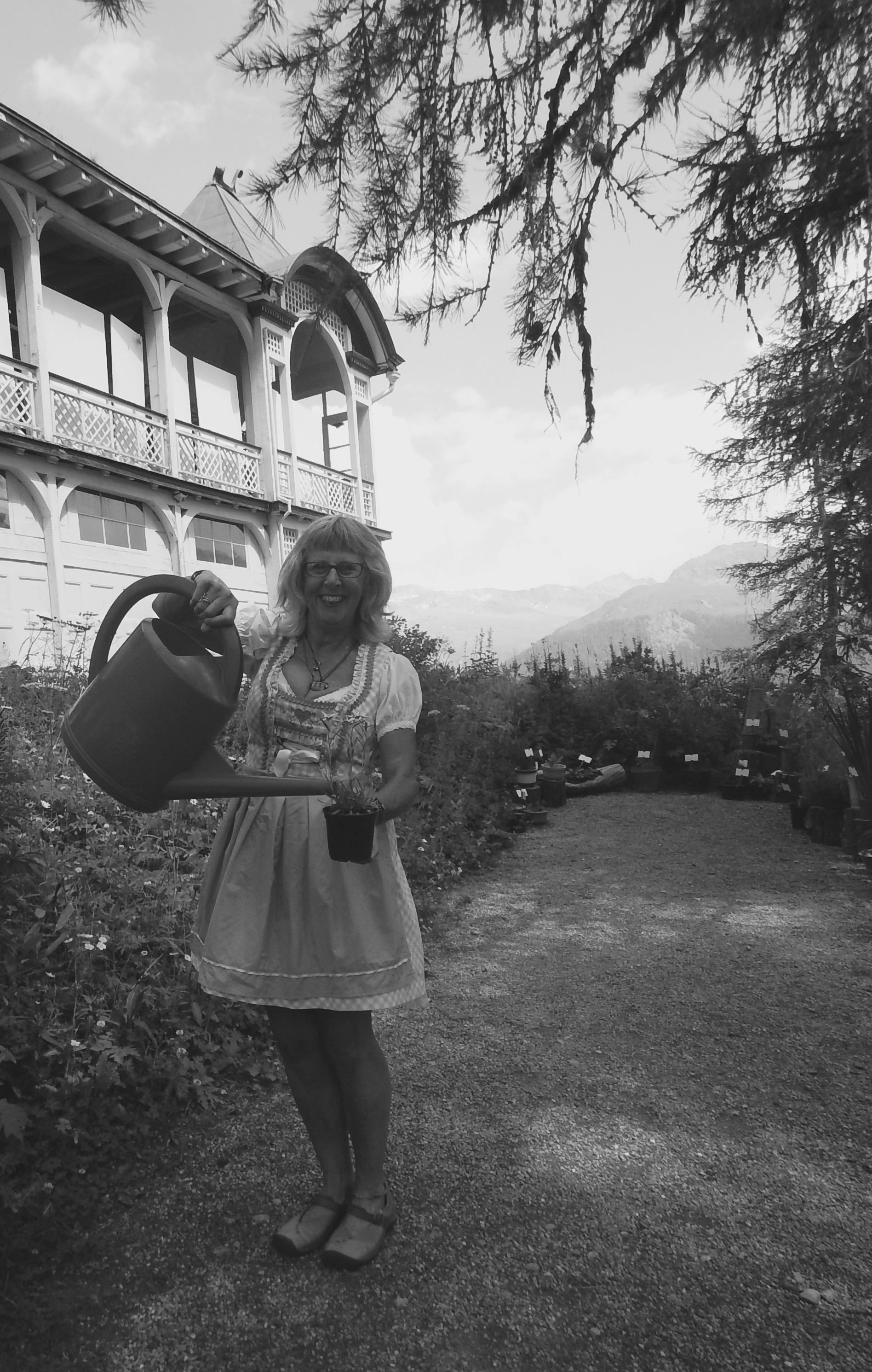 Me wearing a traditional Swiss outfit, working in the garden and holding an eidelweiss flower!