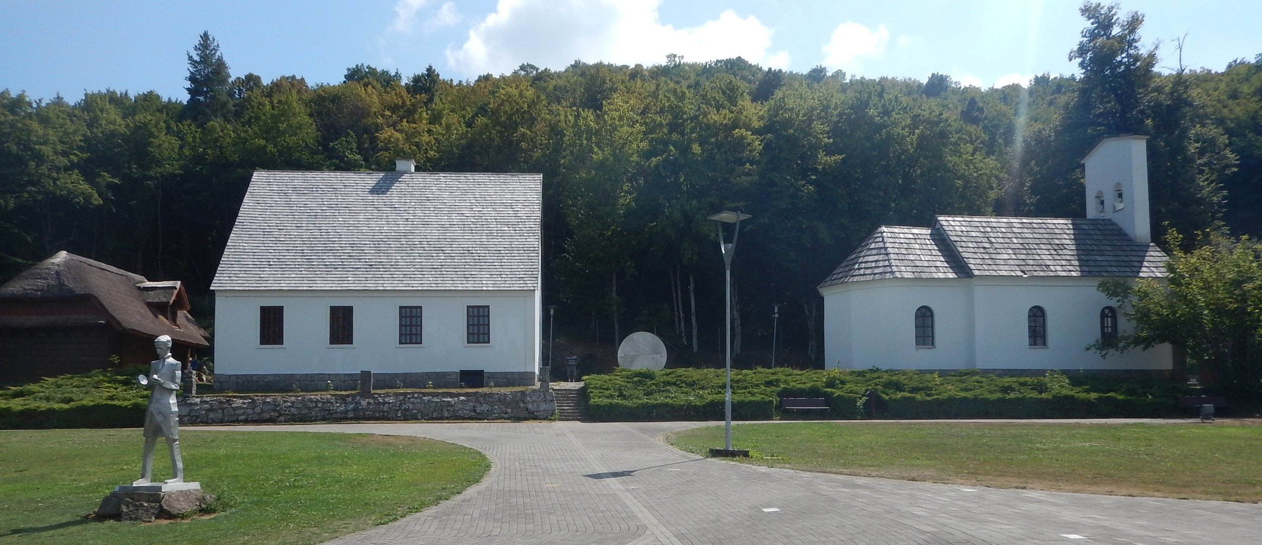 his birthplace is in Smiljan, Croatia. His family home on left and the Orthodox church where his father was the  priest