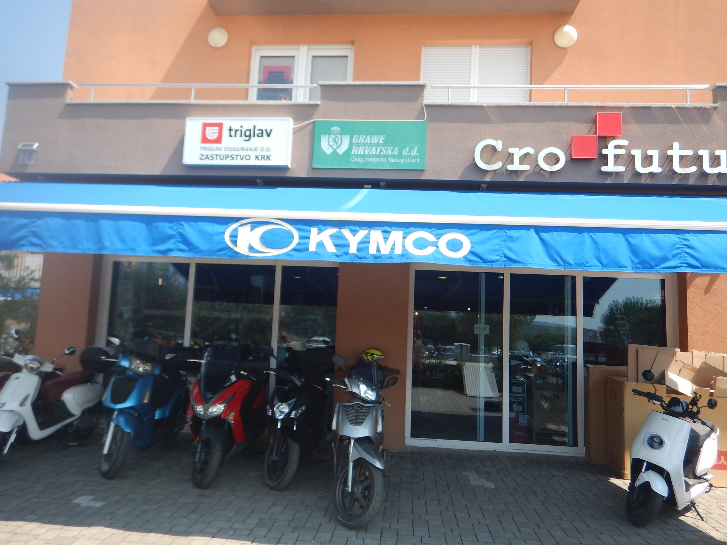 Dinko' Kymco bike shop and service? Centre.