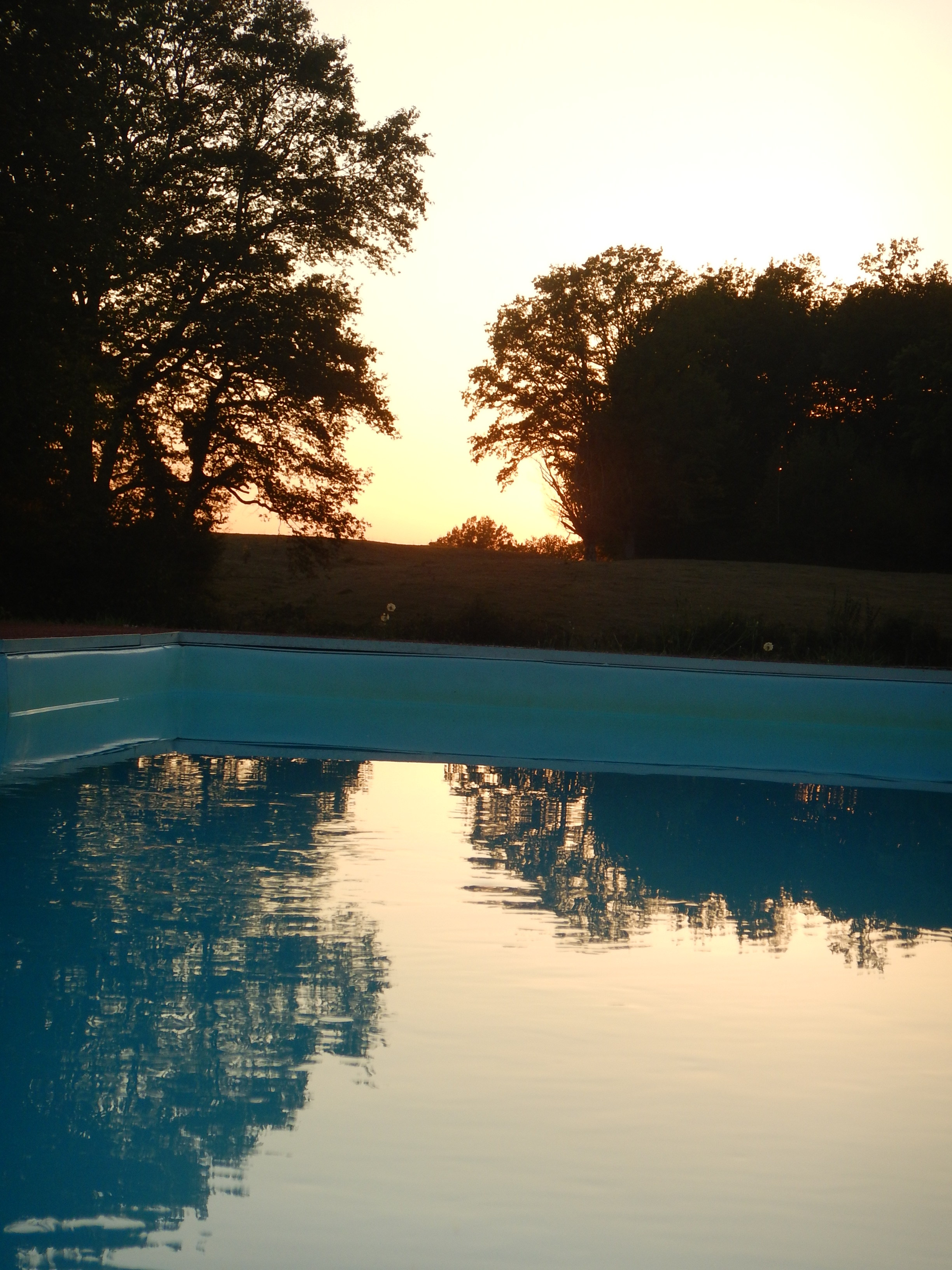 Sunset reflected in the Swimming pool
