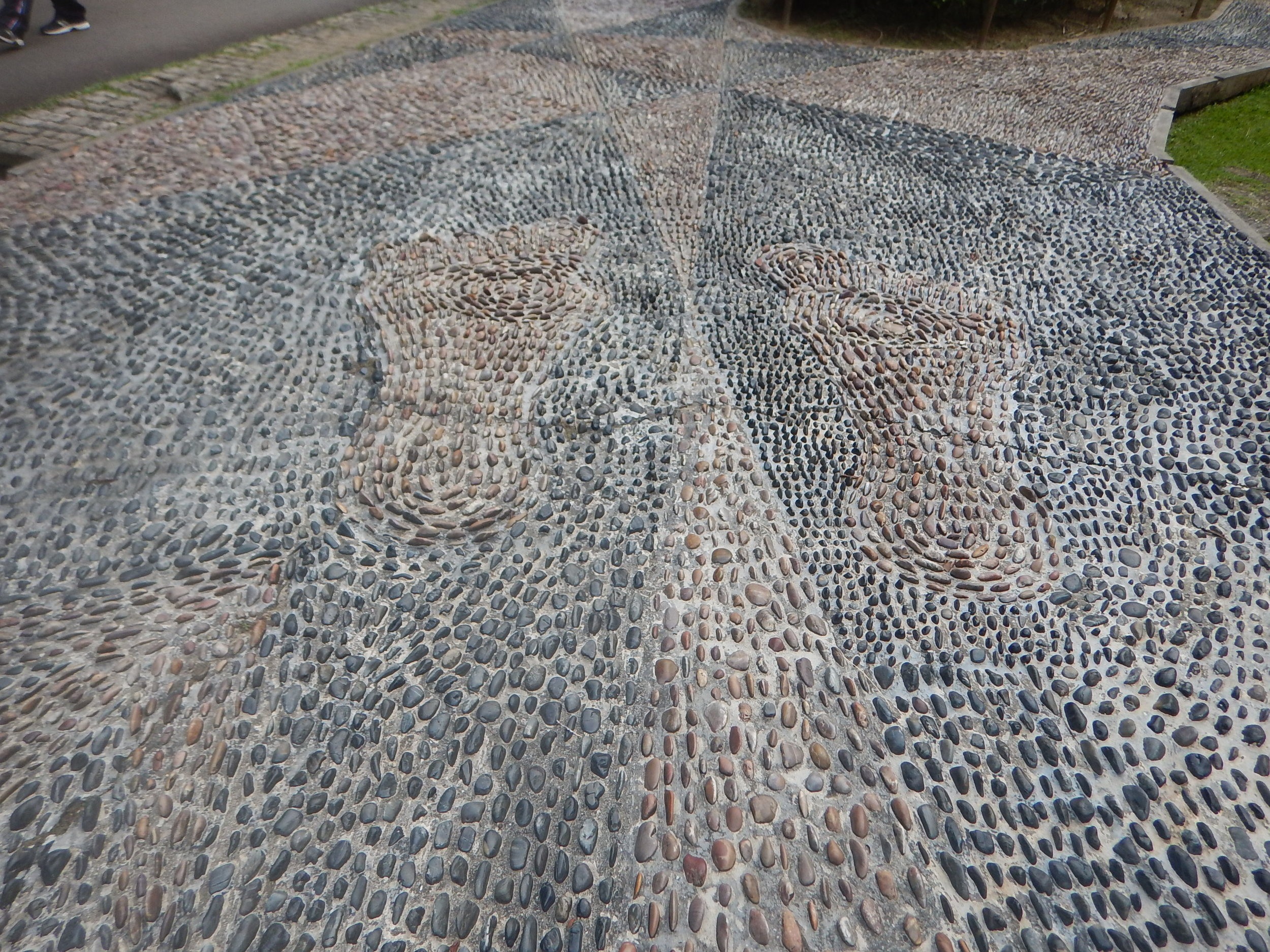 Ouch! These pebble walks are to be walked barefoot. It's like a reflexology treatment.