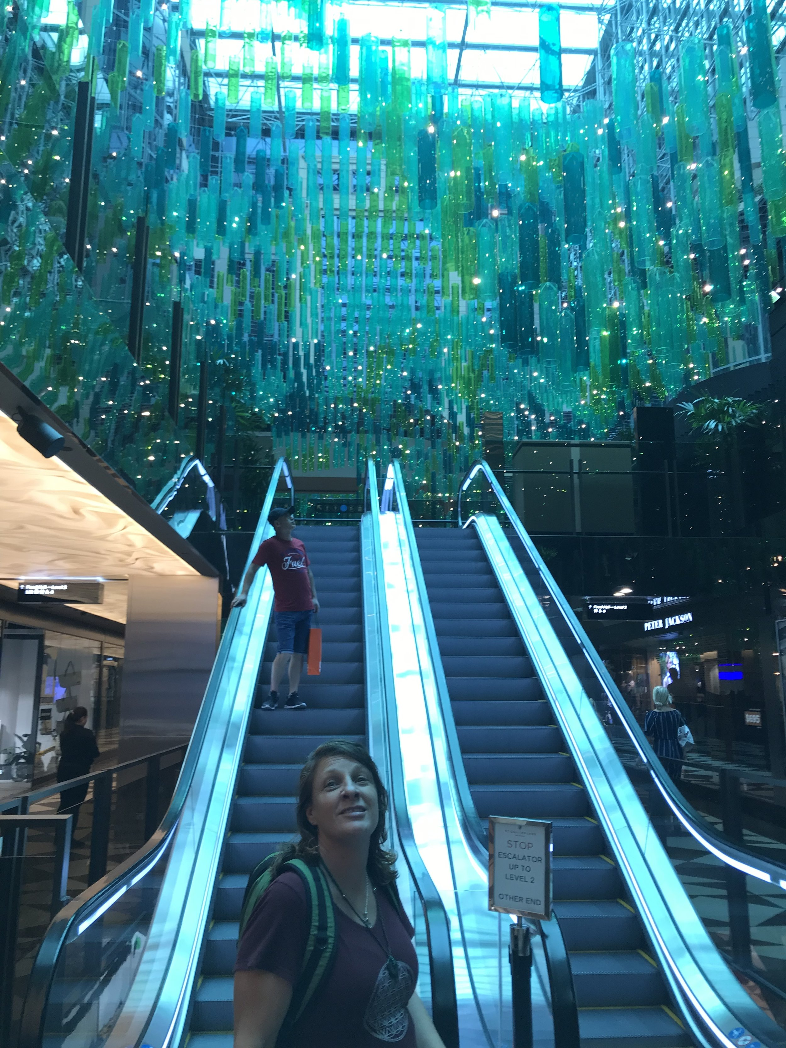 Sandi is in awe of the hanging green bottles in Collins Arcade.