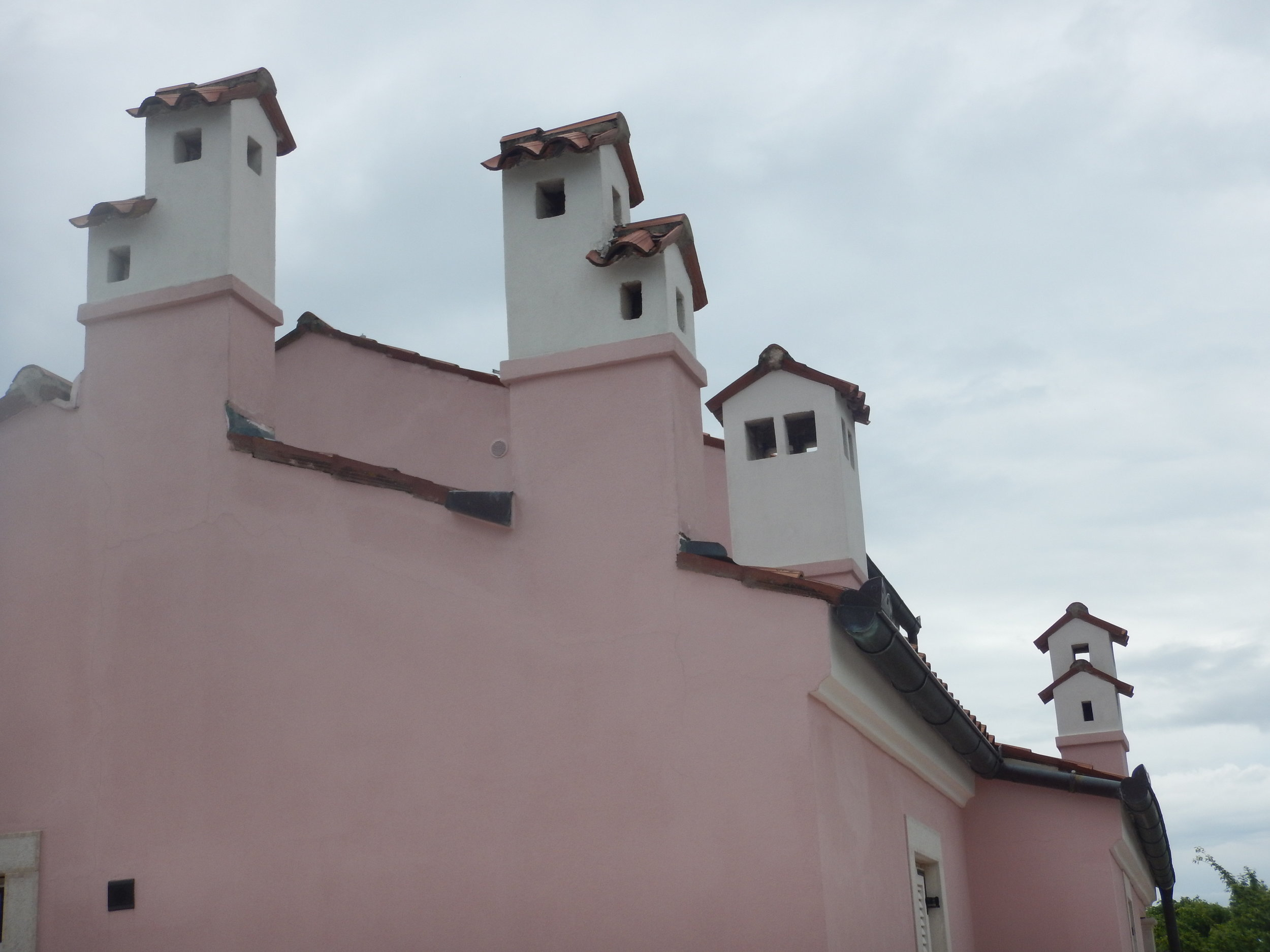 These chimneys look like little houses on top of big houses. Beli Beach House, Cres Island.