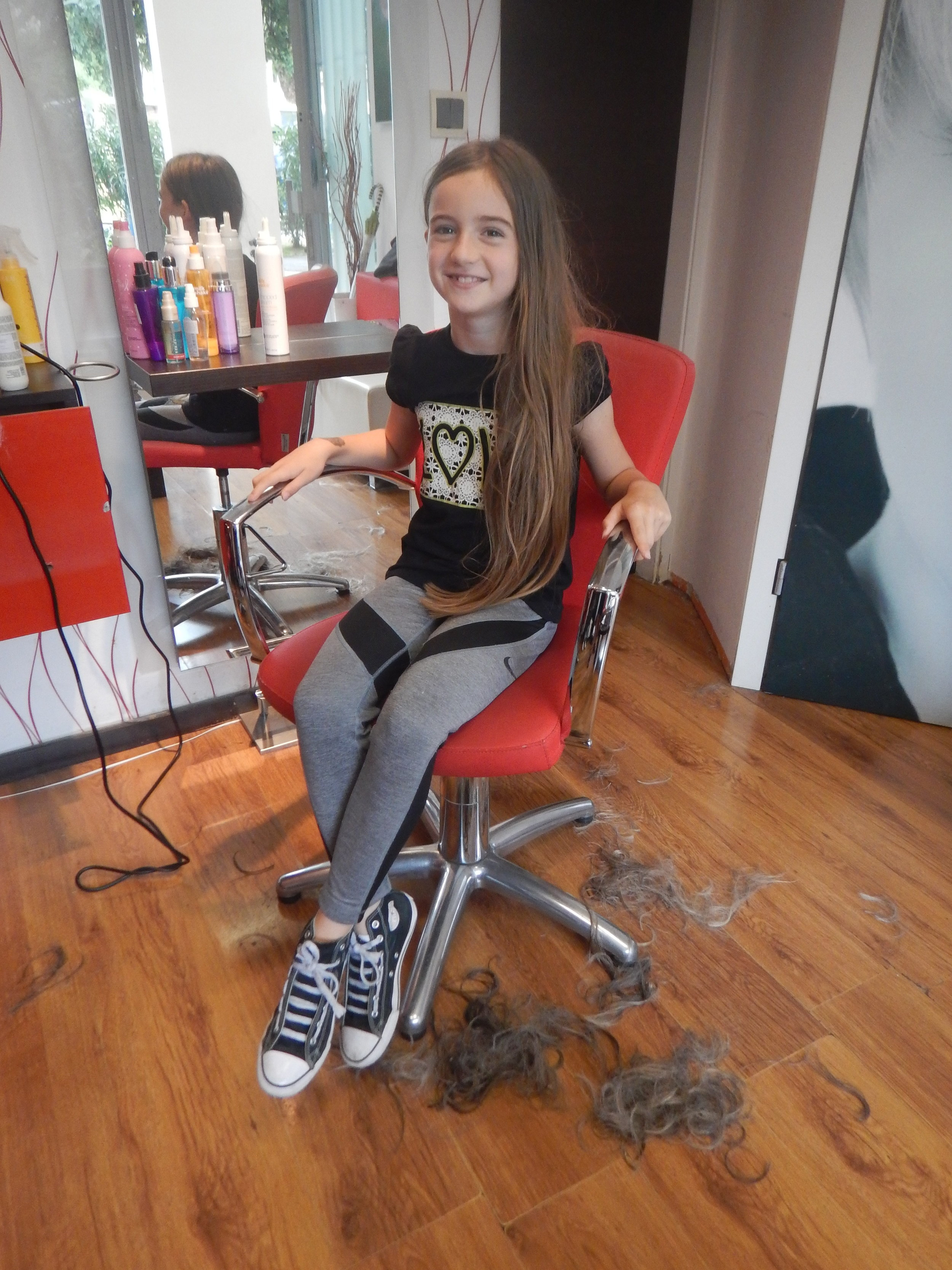 the hairdressers daughter and my grey locks on the floor!