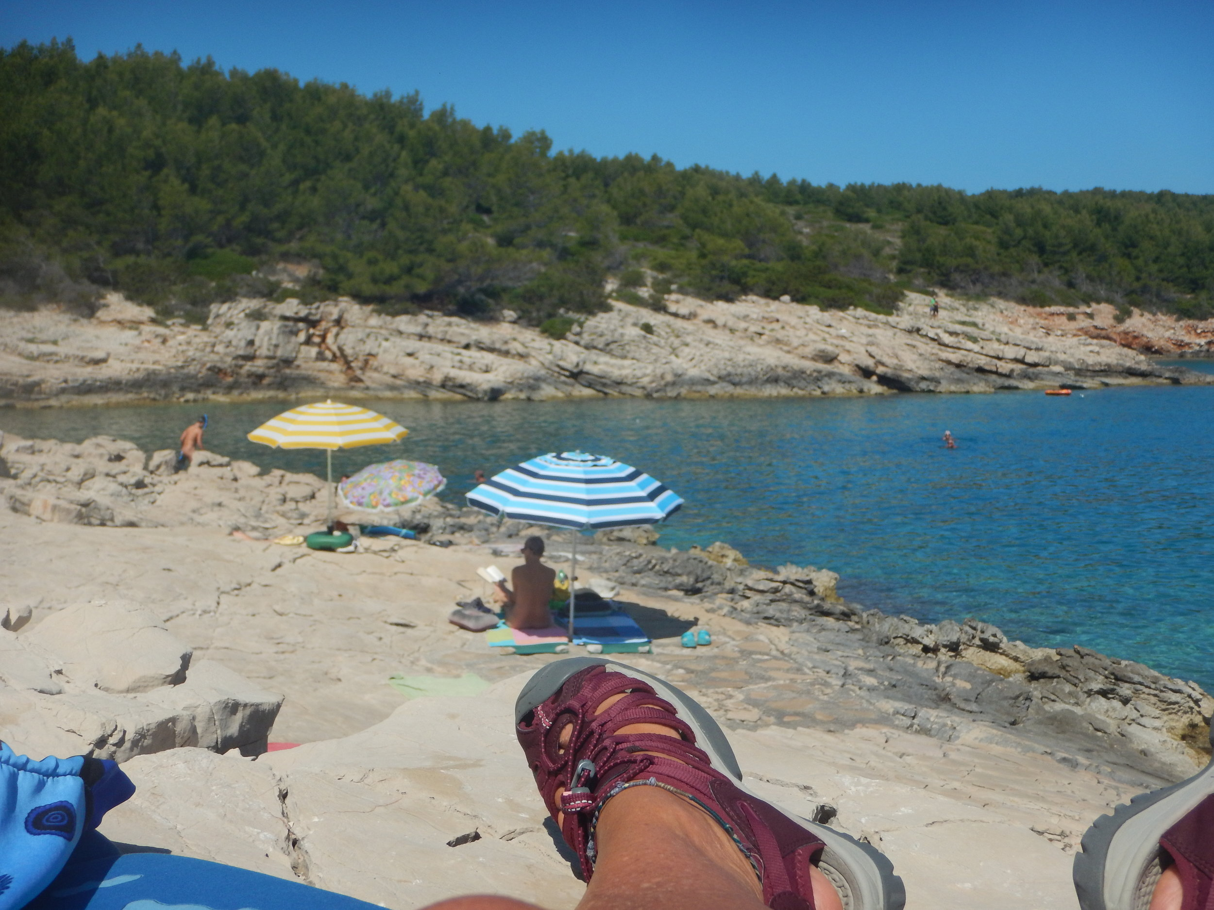 The camp is on a lovely sheltered bay, and lots of rocks to lie on, just like a lizard!