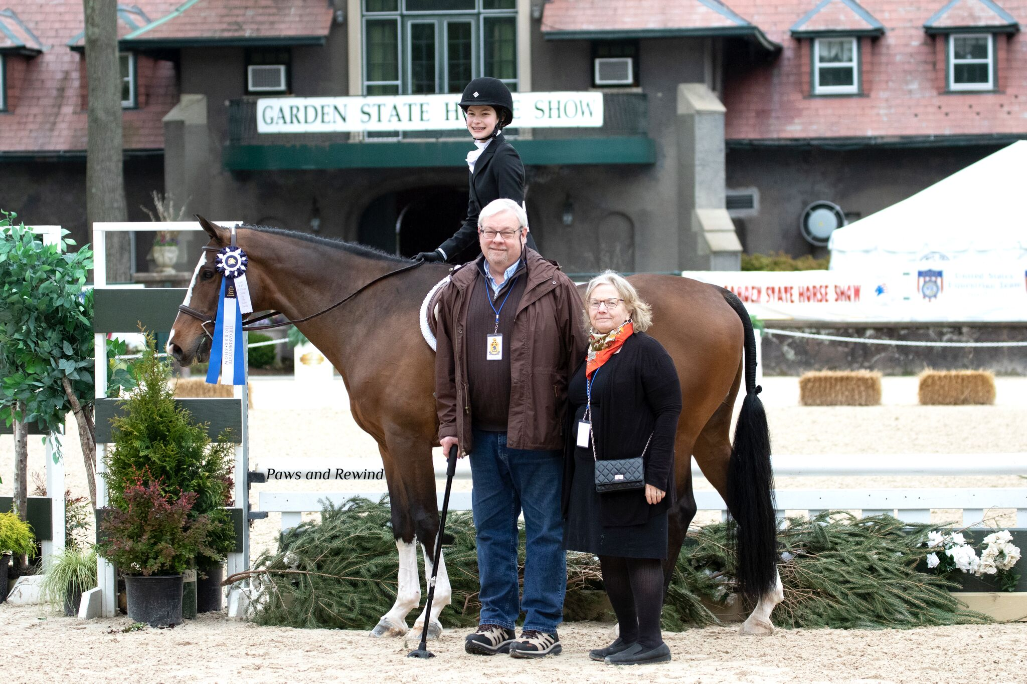 Callia Bergad with sponsors Kim and John Walker. Photo by Paws and Rewind